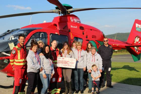 Grils present Cheque to Air Ambulance